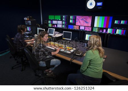 TV Director talking to her Vision Mixer in a Television Gallery.