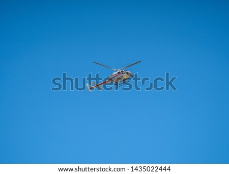 TV Helicopter in the Sky Broadcasts Live Events. Camera. Correspondent flight