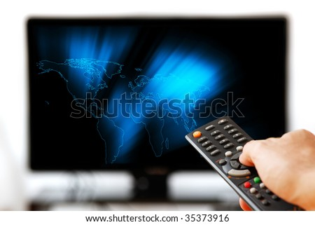 TV LCD set displaying glowing world map. Remote control in man\'s hand. Isolated over a white background.