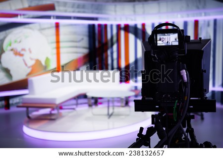 TV morning program studio with camera and lights. Video camera lens - show in TV studio. Television studio with interior and and positioned camera .