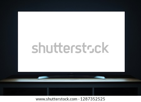 TV OLED blank screen at evening on tv stand