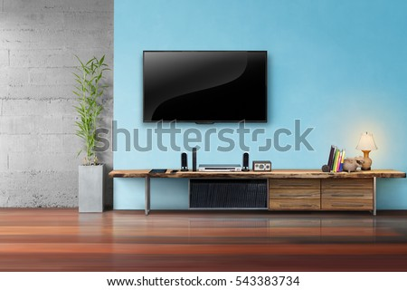 tv on light blue wall with...