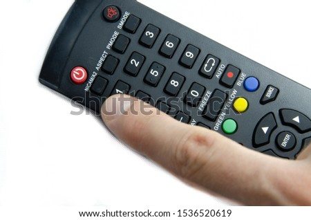 TV remote control in male hands on a white background. Remote control for household appliances, for smart gadgets using the IR port