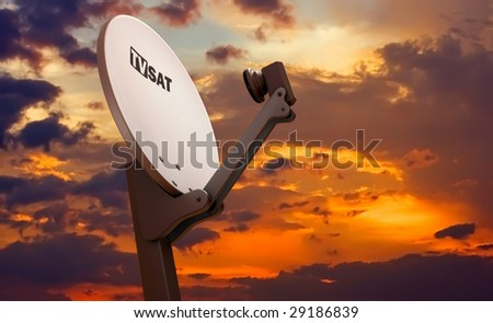TV satellite dish over sunset sky