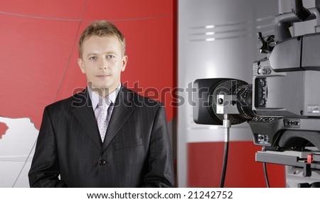 TV studio with video camera and presenter