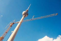 tv-tower at berlin with construction crane