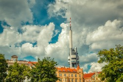 tv tower in prague view from Jiřího z Poděbrad square under bright sun and clouds
