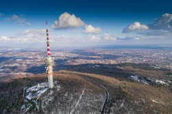 TV tower in winter forest