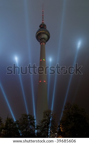 TV tower lit by the blue rays of light, Berlin, Germany - stock photo
