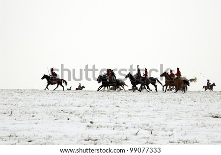 TVAROZNA, CZECH REPUBLIC - DECEMBER 3: History fans in military costumes reenact the battle of Austerlitz, which Napoleon won in 1805, on December 3, 2005 near the village of Tvarozna, Czech Repuplic. - stock photo