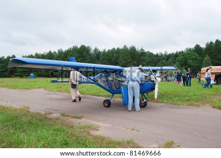 TVER, RUSSIA - JULY 09: Pilot checks engine of the Aeroprakt-22L ultralight airplane during Tver Blue Skies aviation festival on July 09, 2011 in Tver, Russia