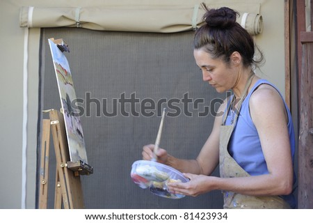 TWEE RIVIEREN - MAY 22: Debra Hilditch, a south african landscape artist works on a canvas of a  kalahari landscape on May 22, 2011 for an upcoming exhibition of south african landscapes