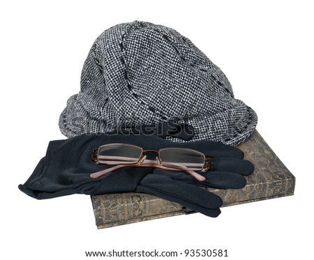 Tweed hat with black gloves and glasses on a book - path included