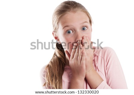tween aged girl holds her hands in front of her face in surprise