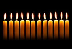 Twelve alight candles over the black background