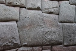 Twelve angled, perfectly cut stone construction with 12 sides (Hatun Rumiyoc) at historic wall from Incas is an old archeological tourist landmark attraction in traditional Cusco, Peru, South America.