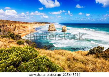 Twelve Apostles in bright turquoise sea along Great Ocean Road in Australia