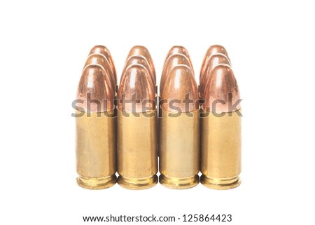 Twelve bullets caliber  9mm isolated on white background