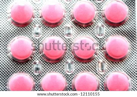 Twelve pink tablets in silver package