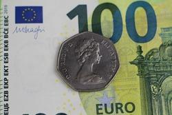 twenty british pence on a hundred euro bank note