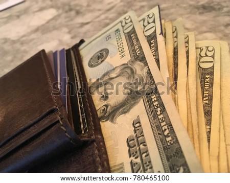 Twenty Dollar Bills Bursting out of Wallet - Wealth Concept #780465100