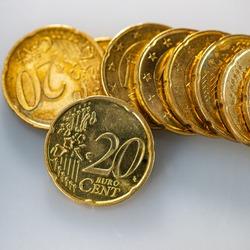 Twenty euro cents coins lie on a light background, close-up. Business concept. Web banner.