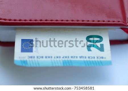 Twenty euros. Twenty euros invested in a red notebook. Money. #753458581