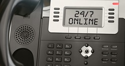 Twenty four seven online - concept of text on the IP phone display. Closeup IP Phone