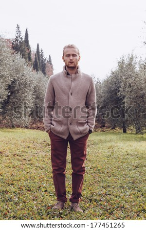 Twenty four year old man with blue eyes and blonde hair in a day of winter in a park  Photo stock ©