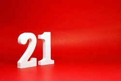 Twenty One ( 21 ) white number wooden Isolated Red Background with Copy Space - New promotion 21% Percentage  Business finance Concept