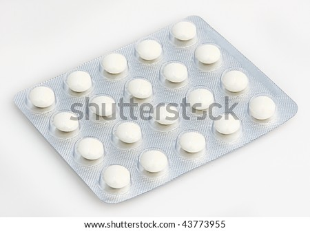 Twenty round colorless tablets in a blister pack isolated on white