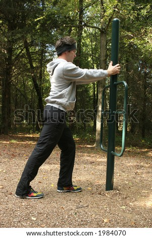 Twenty-six year old man working out at park.