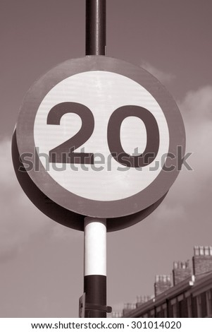 Twenty Speed Sign in Urban Setting in Black and White Sepia Tone