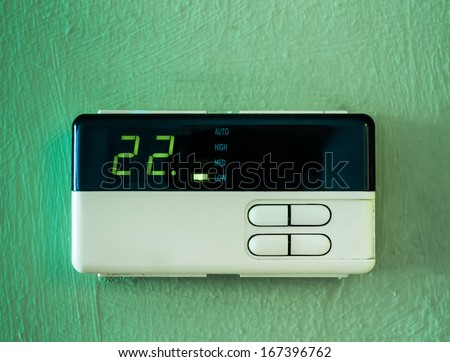 twenty two  celsius heating and cooling air conditioning display on green wall