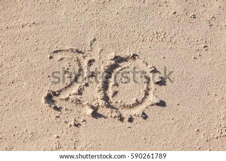 Twenty written in beach sand. #590261789