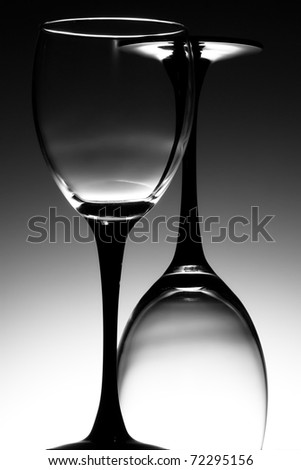 Twi wine glasses one the correct way up and one inverted