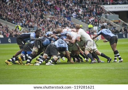 TWICKENHAM LONDON - NOVEMBER 10: English players in Scrum with Fijian Team kick at England vs Fiji, England playing in white Win 54-12, at QBE Rugby Match on November 10, 2012 in Twickenham, England.