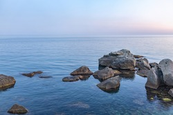 Twilght over the wild rocky beach coastline and the sea. Sea and rocks at night wide angle view. Panoramic landscape in Crimea, Nora, near Alupka town.