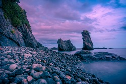 Twilight at Ampere Beach, Dipaculao, Aurora. Pebble beach and rock formations along the east coast of Luzon.
