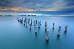 Twilight at concrete pillar in the sea at Pattaya,Thailand