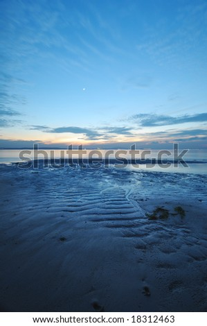twilight at the beach during low tide