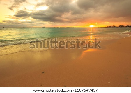 Stock Photo Twilight at Waikiki beach in Oahu. Waikiki beach is a beautiful place to enjoy the sunset over the ocean. Waikiki in South Shore, is the neighborhood of Honolulu and the most popular beach of Hawai.