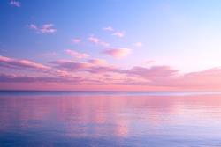 Twilight Dusk. Beautiful clouds over the calm sea.