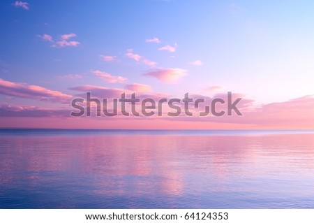Twilight Dusk. Beautiful clouds over the calm sea. - stock photo