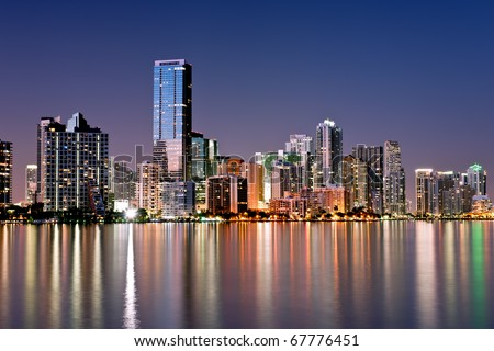 twilight glow on skyline of miami along biscayne bay on cloudless, calm evening, december 2010.  actual reflections, high resolution capture