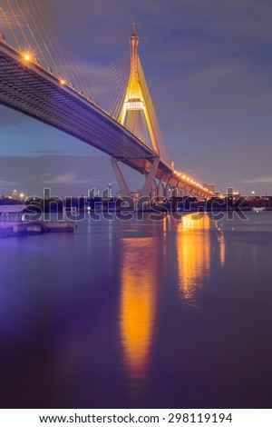 Twilight of Bangkok Suspension bridge with water reflection, Thailand #298119194