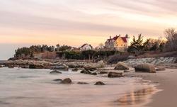 Twilight Seascape of Nobska Lighthouse and Rocks on Cape Cod Beach