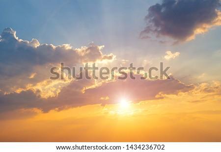 Twilight sky background. Colorful Sunset sky and cloud. vivid sky in twilight time background. Fiery orange sunset sky. Beautiful