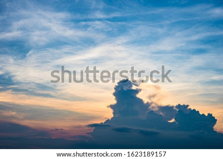 Twilight sky background with Colorful sky in twilight background. Bright Blue, Orange And Yellow Colors Sunset.