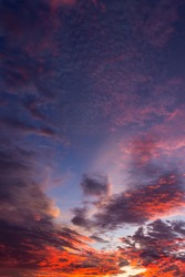 Twilight sky in the evening vertical with beautiful sunset red sunlight on clouds fluffy